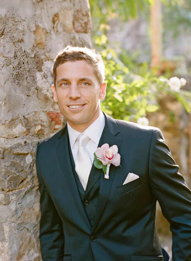The groom wore a light pink orchid wrapped in white ribbon for a boutonniere.