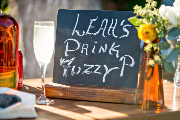 """Two signature cocktails were served in addition to the full bar. The bride's custom cocktail was called a """"Fuzzy-P,"""" and was a lighter peach flavored vodka option."""