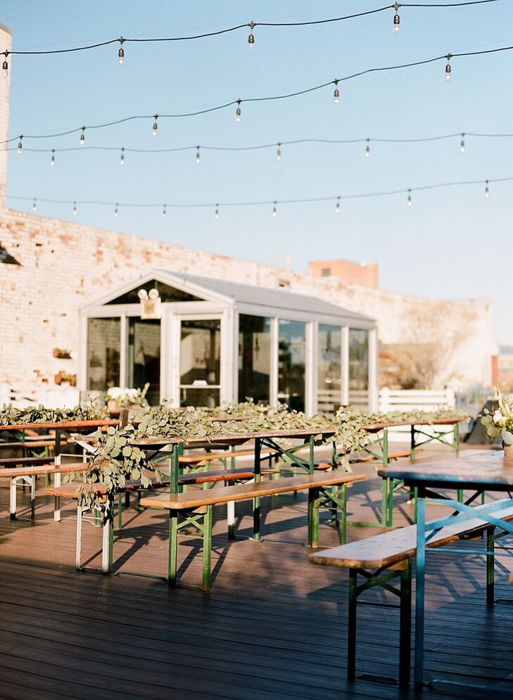 The 2,000-square-foot rooftop features wooden plank floors, string lights, a serving bar and casual picnic tables.