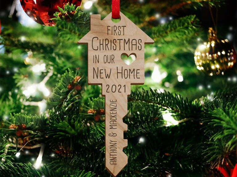 Wooden key and home shaped ornament with 'First Christmas in Our New Home' engraved at top