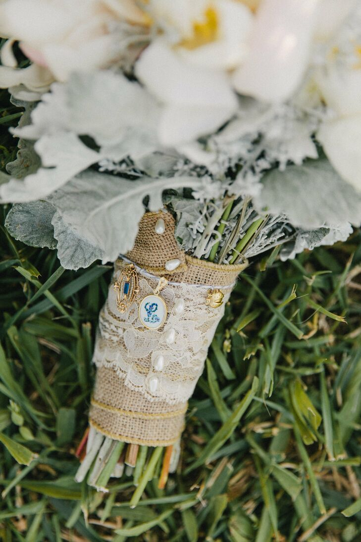 Lindsay wrapped her bouquet in burlap and lace, and decorated the wrap with heirloom charms from her godparents and her late father.