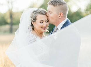 A bright and cheerful color palette punctuated by coral and orange set the tone for Erin and Ryan's poolside wedding at Cypress House in New Columbia,