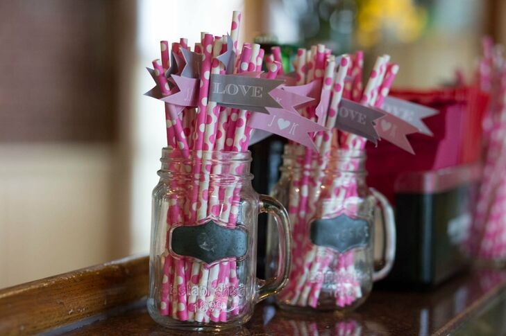 During cocktail hour, guests sipped drinks through pink-and-white polka dotted straws, which were personalized with monogrammed flags.