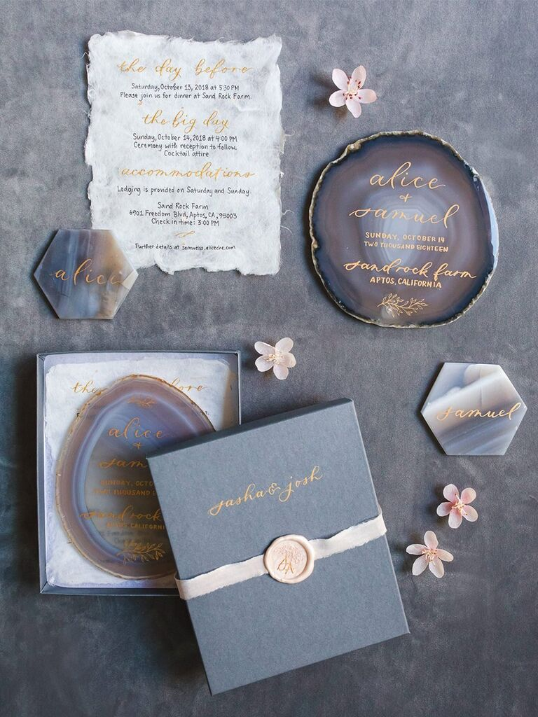 Blue agate invitations with gold script, navy box with pink wax seal and white ribbon