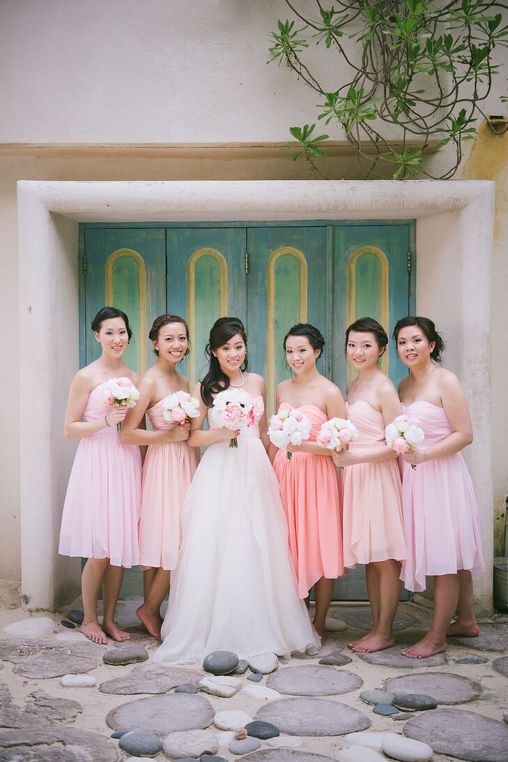 The bridesmaids all wore a strapless pink dress with a sweetheart neckline and a ruched bodice, just like Sharon's wedding dress. To change it up, their dresses created a pretty ombre effect in blush, peach and coral. The groomsmen's bow ties matched this style in varying shades of pink.