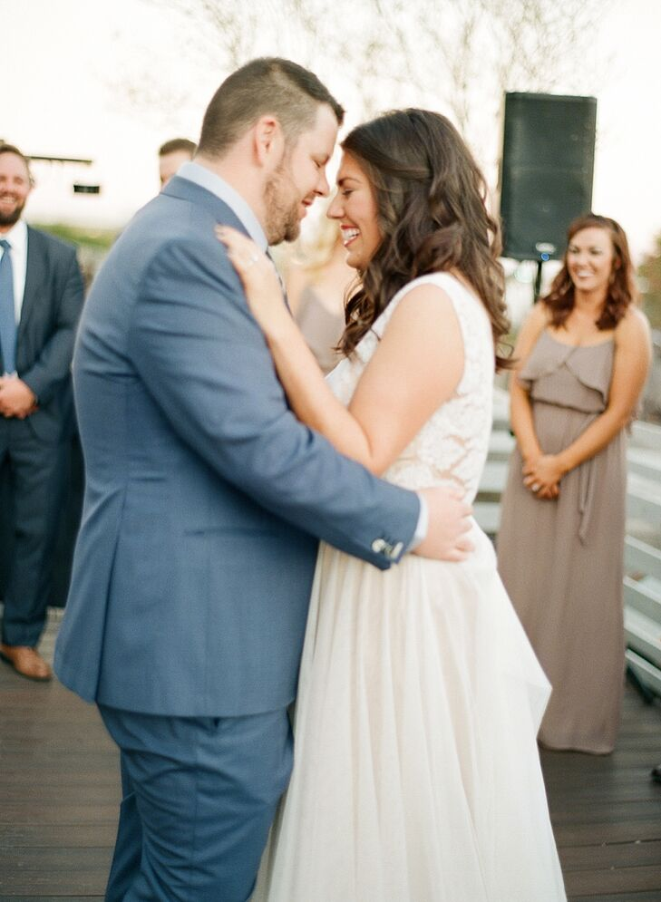 """Marissa and Scott's first dance was to Aaron Neville's """"Crazy Love,"""" with includes the lyrics """"I can hear her heartbeat from a thousand miles, and the heavens open up every time she smiles."""" The singer was a favorite of Scott's mom."""