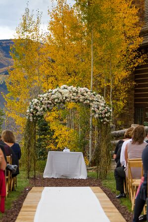 An Elegant White Floral Ceremony Arch