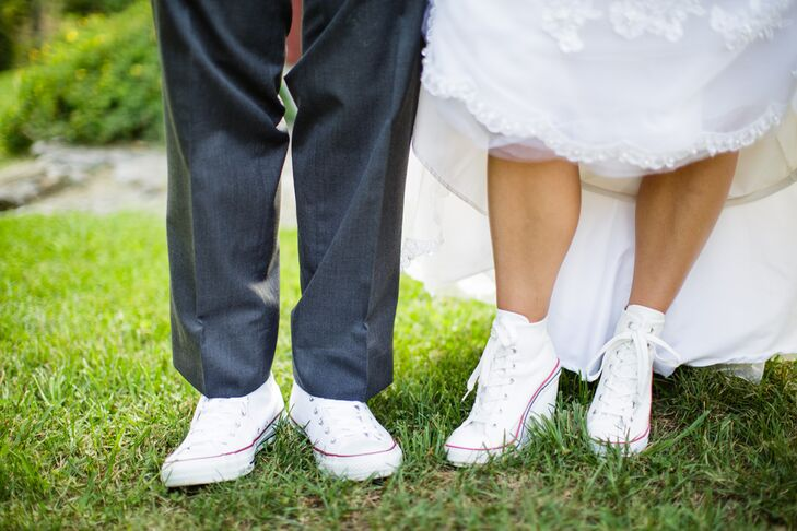 After the ceremony and a few photos, the couple switched out their dress shoes for something a little more comfortable. They both wore lace-up white sneakers rom DSW with a slight red and blue trim. Kristie's shoes even had a wedge heel so it would be the right length for her ball gown.
