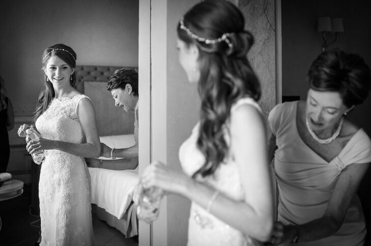 Zoe wore a lace Justin Alexander dress with an illusion neckline. She styled her hair half-up and wore a crystal hair accessory for some sparkle.