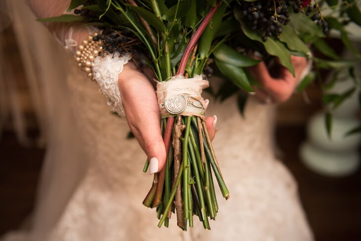Brooklyn carried a bouquet of roses in burgundy, white and dusty rose. Wrapped around the stems was a gift from her aunt; an antique English sixpence. Such coins were commonly carried by brides in the early 1900s and added an elegant touch to the bouquet.