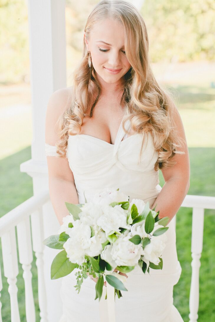 Lydia held a lush bouquet filled with pure white peonies and leafy greens. The arrangement blended in nicely with her romantic J. Mendel dress, which had off-the-shoulder sleeves and a sweetheart neckline.