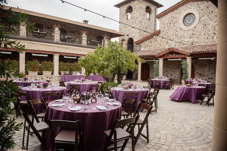 At the outdoor reception, round dining tables scattered around the stone surface had purple linens and purple flower centerpieces. Each table had a number made of wine corks provided by Jacuzzi Family Vineyards, adding a nice personal touch to the decor.