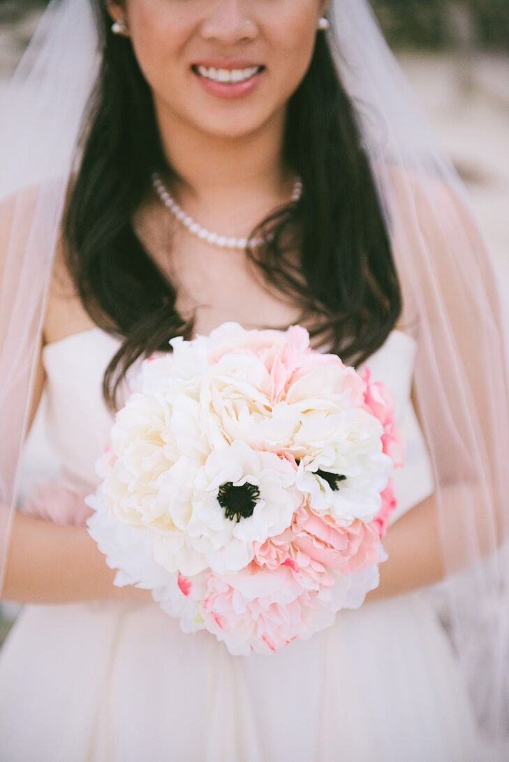 Peonies were not in season and hard to find in Jamaica, but Sharon was set on having them be in her wedding—they're so romantic! Instead, she went on afloral.com and found silk peonies. One of her crafty bridesmaids made her round bouquet totally DIY, and we think it's gorgeous.