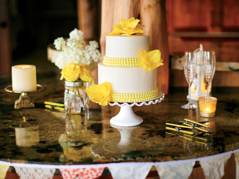Yellow and white two-tier wedding cake