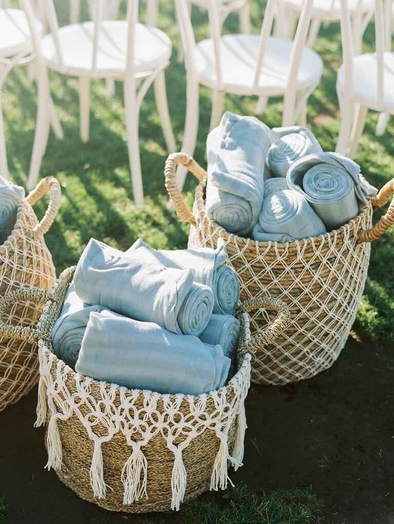 straw macrame basket of light blue blankets pashminas as wedding favors