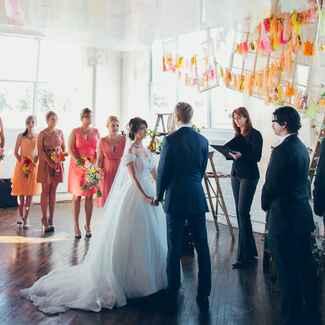 Vow exchange ceremony at bright DIY wedding