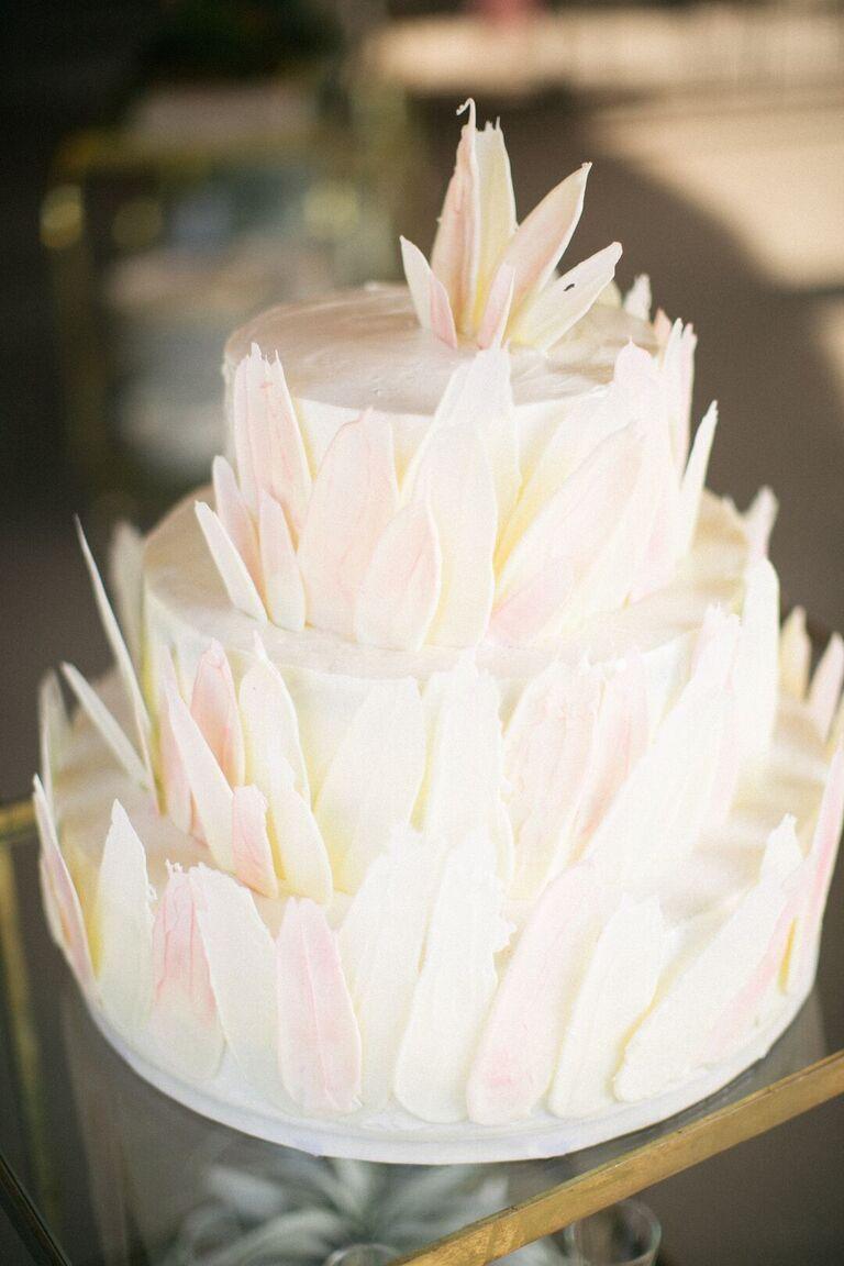Three-tier modern wedding cake with brush stroke details