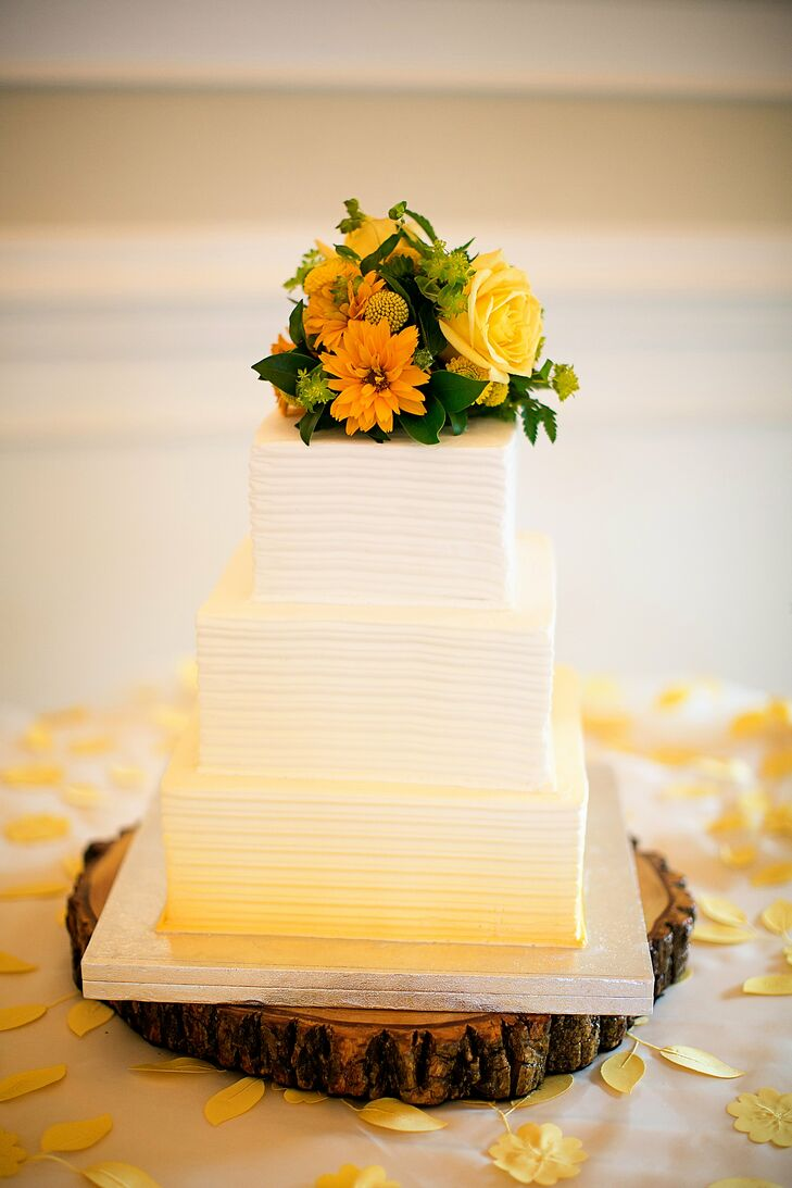 The three-tiered confection featured a yellow-ombre effect and was topped with orange and yellow flowers.