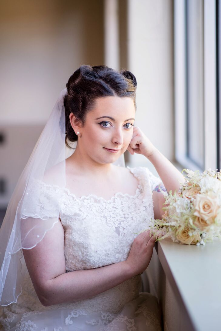 Leah wore her hair in tight victory rolls to complement her vintage-inspired lace wedding dress and retro-themed celebration. The entire look was inspired by looking at her grandparents's old wedding photos.
