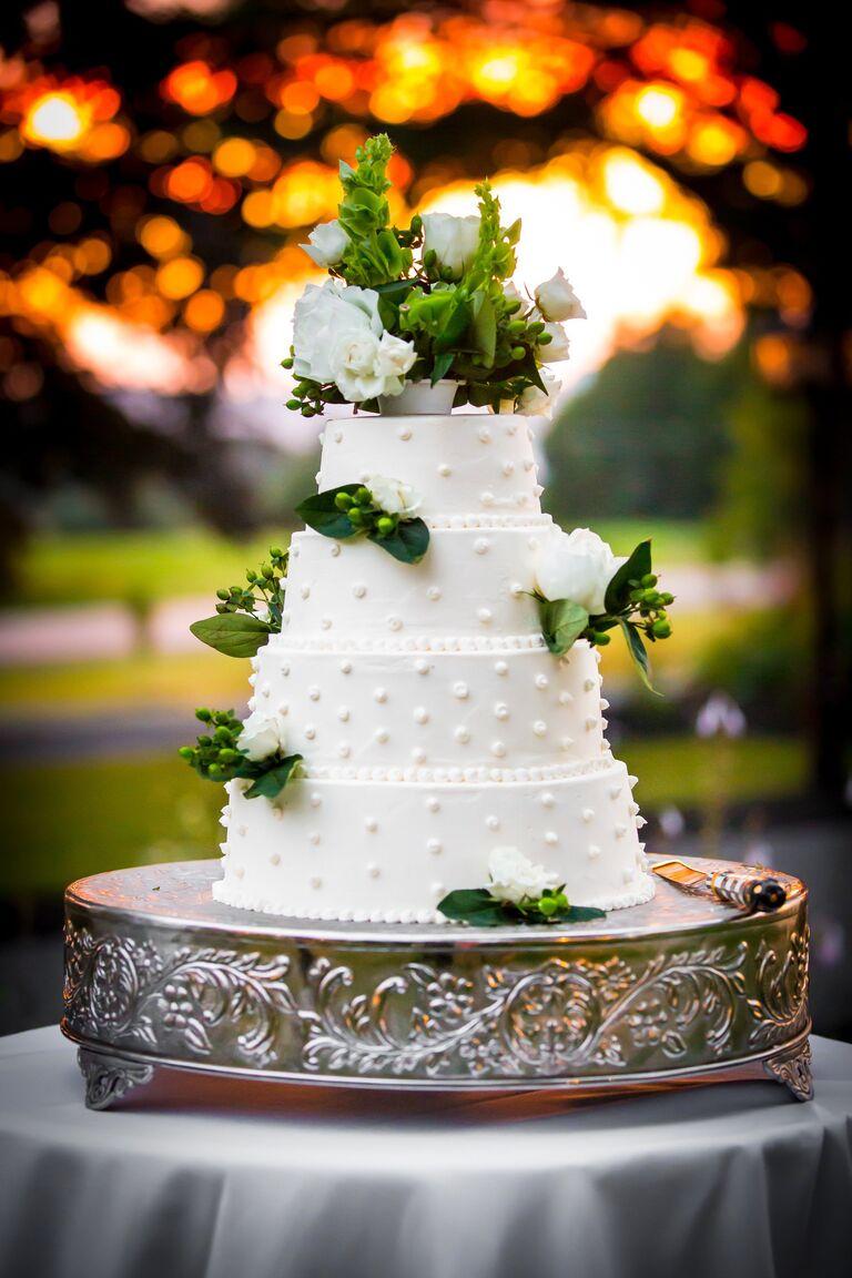 White buttercream wedding cake with Swiss dot design