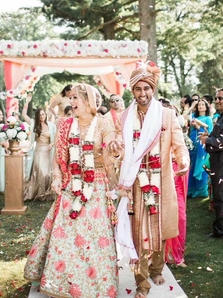 """""""We wanted our wedding to bring our two sides of the family together so that affected every decision we made,"""" says Arselie. One of those decisions was to have customized programs at both the Catholic and Hindu ceremonies so each side could follow what was happening."""