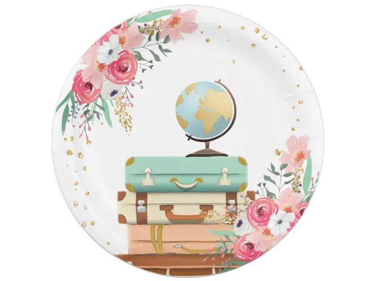 Paper plate with pink and white florals, gold flecks and globe and luggage graphics