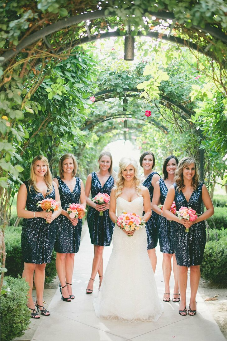 The bridesmaids wore navy sequined dresses by Badgley Mischka, which Kendrick found on Rent the Runway. The shimmery dresses tied into the wedding's glam theme and complemented the sequined linens and glittery accents found throughout the reception.