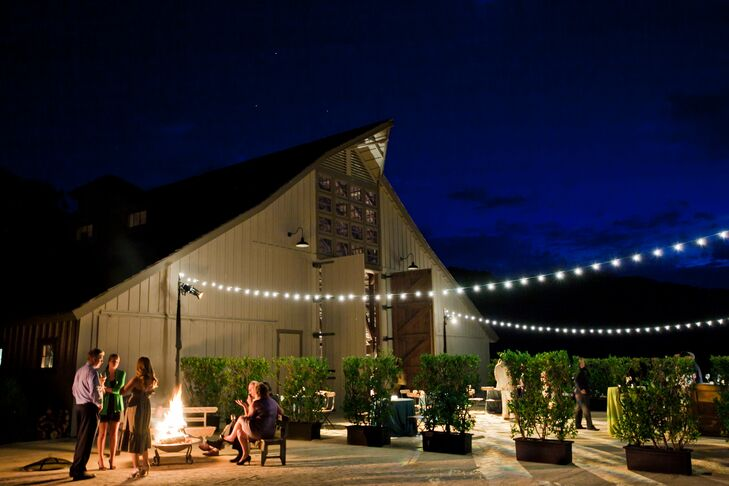 A lounge area and additional bar right outside the barn ensured guests never had to stand in line for a drink! Fire pits and market lights provided a warm, dreamy glow as the night wore on.