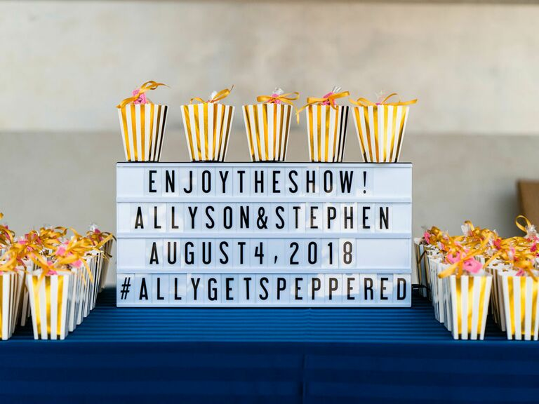 Marquee sign with wedding hashtag