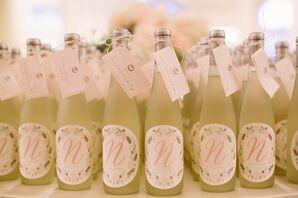 Wine Bottle Escort Cards with Newlyweds' Monogram