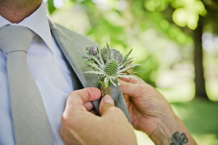 Groomsmen donned twine-wrapped boutonnieres made from thistle and succulents in lieu of more traditional blooms.