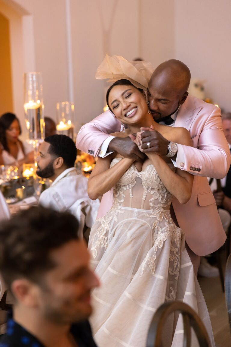jeezy kisses jeannie's neck at the wedding reception so much love