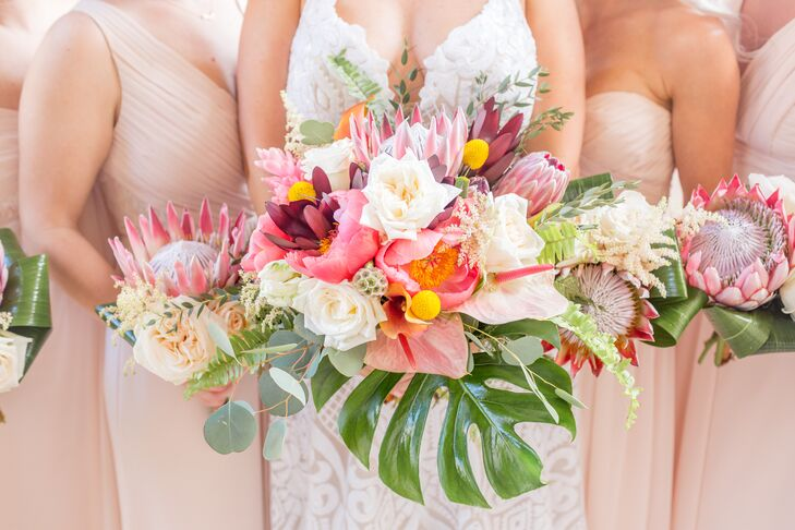 Lush King Protea and Tropical Leaf Bouquets