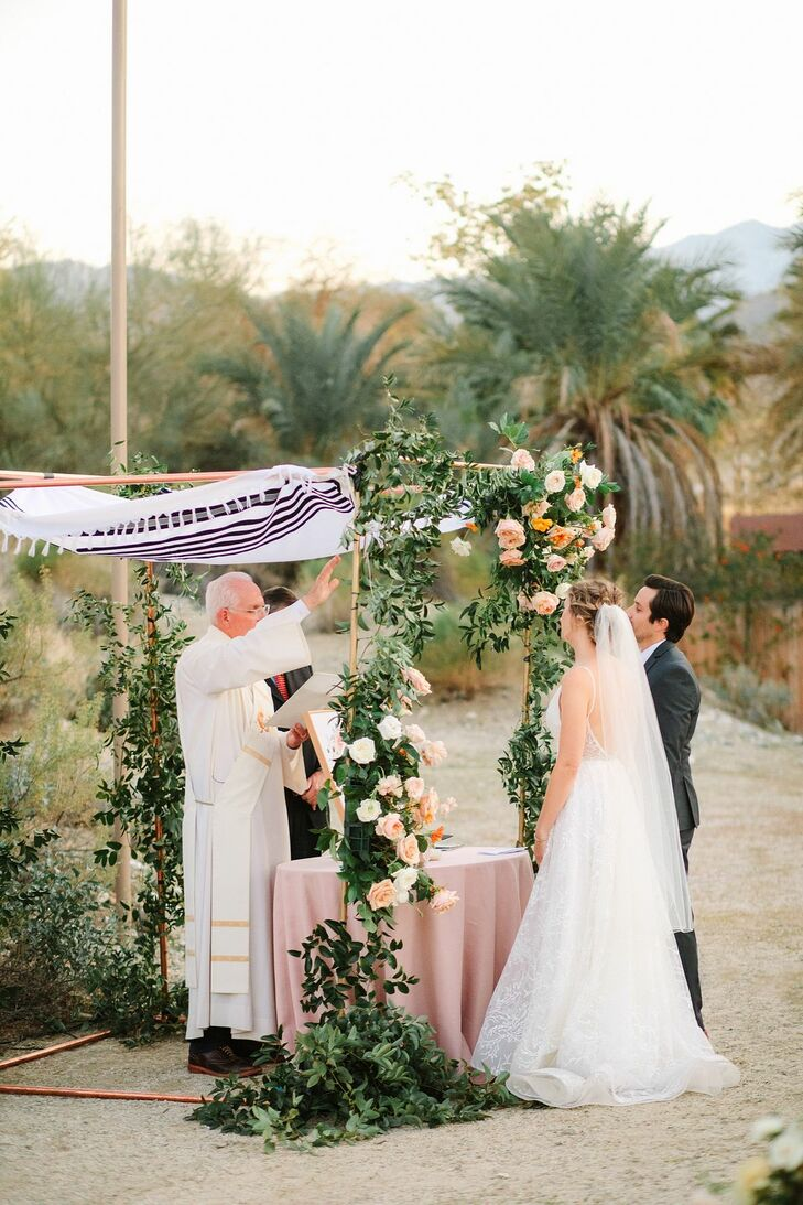 Rabbi Offering Blessing During Jewish Wedding Ceremony at The Living Desert Zoo and Garden in Palm Desert, California