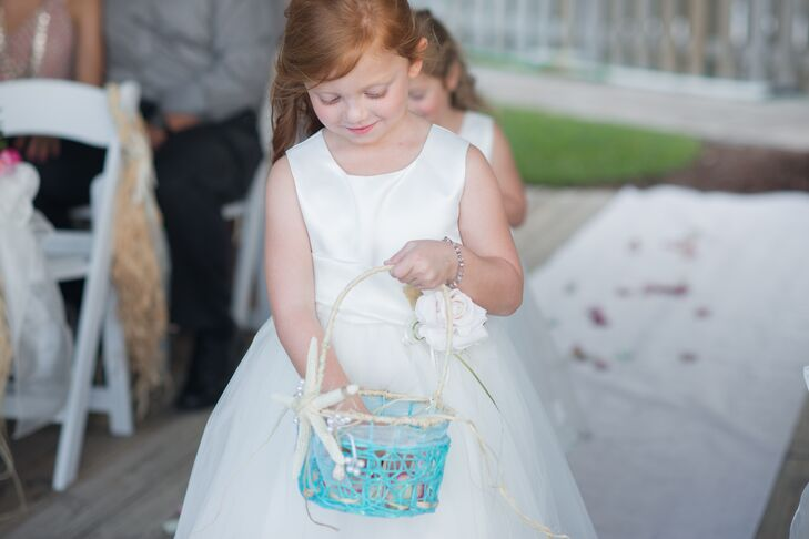 Each of the couple's flower girls wore a white sleeveless dress with a rosette detail along the waist and tulle skirt from Zulily.com.