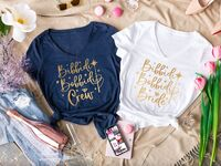 Bibbidi Bobbidi shirts with gold type, bridal party's in blue and bride's in white