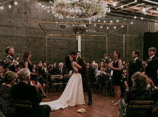 """When planning their wedding, Lara Steele and Jacob Rosen wanted a """"goth meets industrial meets disco vibe with a splash of Burning Man thrown in,"""" the"""