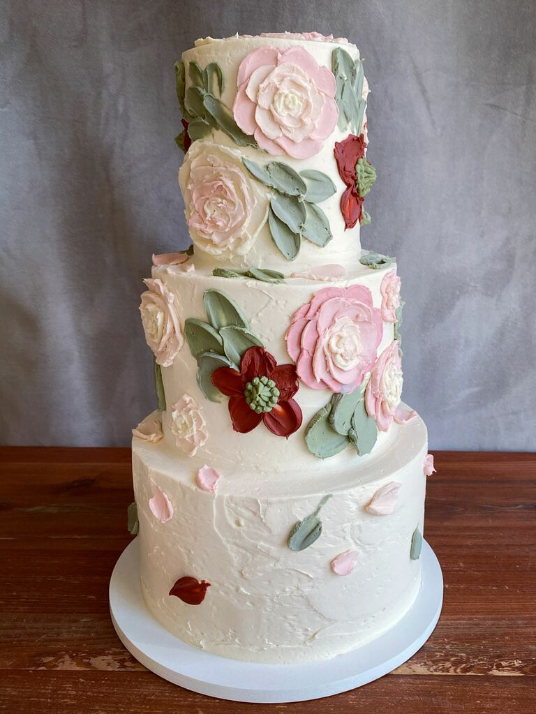 Three tier white bridal shower cake with icing flowers and leaves