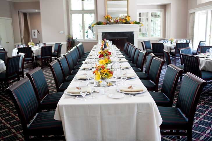 At the reception venue, tables were dressed in white linens and were set with matching colored dinnerware. The middle of the table was decorated with colorful centerpieces made up of summer flowers.