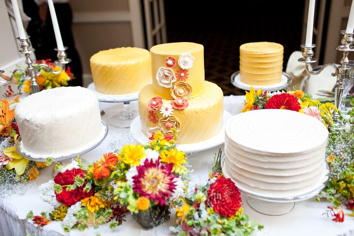 There were five weddings cakes that had either white or yellow icing, and the main two-tiered yellow wedding cake was decorated with sugar flowers.