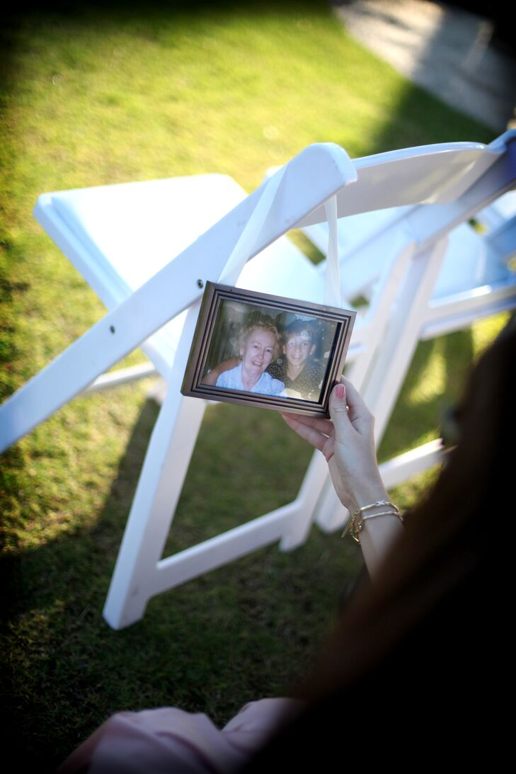 Chairs at the ceremony were decorated with hanging frames of pictures of Melissa, Evan and their loved ones.