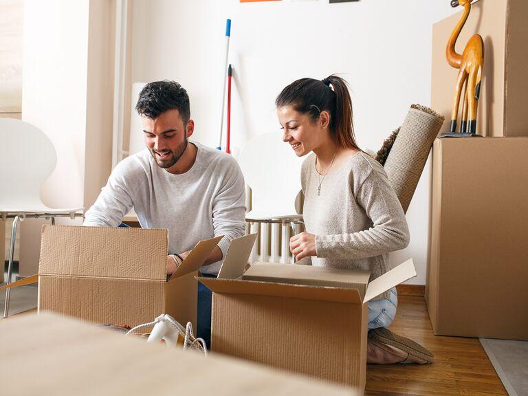 Couple unpacks boxes