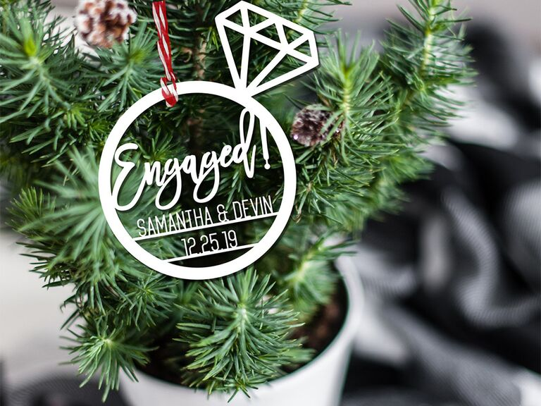 Ring cut out ornament with 'Engaged!' and couple names in center