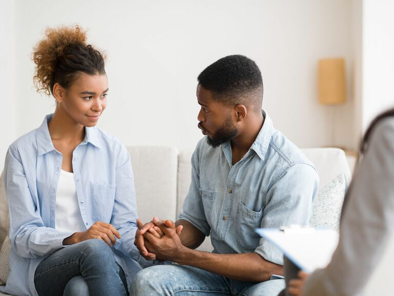 Millennial couple talking during couples therapy session