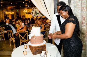 Couple Cutting Wedding Cake at Mt. Washington Mill Dye House in Baltimore, Maryland