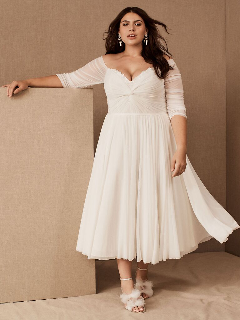 bhldn watters cream a line wedding dress with ruched sweetheart neckline ruched mid-length off the shoulder sleeves and flowy pleated tea length skirt