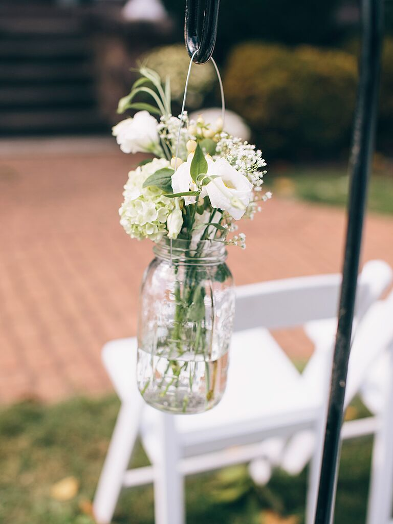 DIY wedding ceremony aisle decor with hanging florals