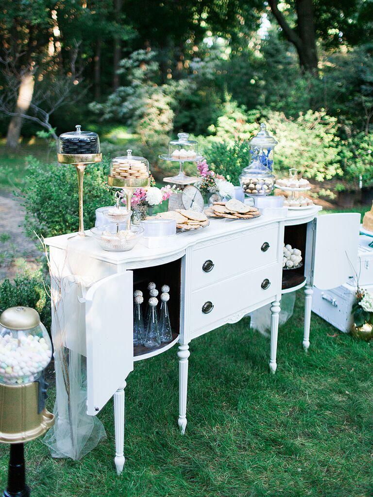 Vintage sweets bar dessert station for a wedding reception