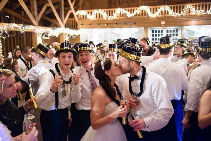 """After dinner and the traditional first dances, guests enjoyed dancing to live music before the countdown to midnight. """"Around 11:30, we passed out noise makers and 2015 tiaras and at 11:55, everyone gathered on the dance floor with a glass of champagne and waited for the countdown,"""" says Rachel. """"At midnight, we all cheered and celebrated the amazing year that had just ended and the new year as the Hennessy family of two!"""""""