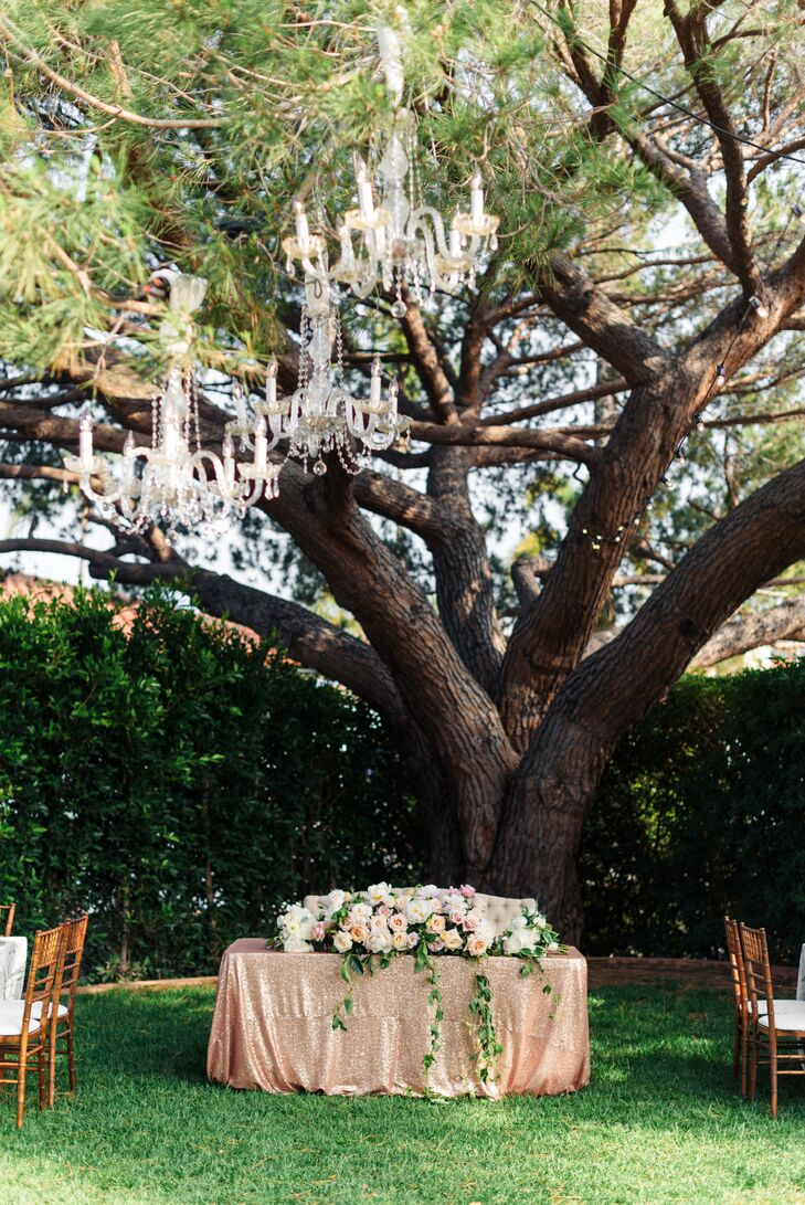 For added elegance and ambiance at the backyard reception at the Riviera Mansion in Santa Barbara, California, chandeliers were hung in the trees.